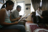 11 year-old Valeria Rocha (cq), and her cousin, 11 year-old Efren Flores (cq), read their new...