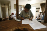 11 year-old Efren Flores (cq), signs his new school contract with West Denver Prep, as Mr....