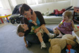 DM0694  Amber Shearer, 24, hangs out with her two-year-old twins Atticus and Damia Tyler at their...