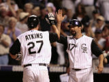 Rockies Garrett Atkins is congratulated by Todd Helton after Atkins hit a two-run homer in the...