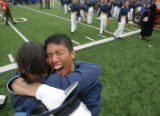 Mario Mendoza hugs a fellow graduate at the Air Force Academy graduation in Colorado Springs,...