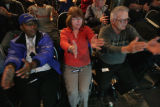 Zeyna Mohammed, Ellen Riley and Jim Hill all with Super Shuttle performs one of the exercises -...