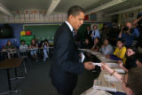 MJM1052  Barack Obama takes a note from Theo Rodriguez that was given to him by his father to give...