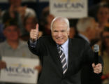 NHJC101 - Republican presidential candidate Sen. John McCain acknowledges the crowd as he arrives...