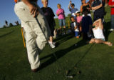DM0136  Dustin Jensen, Director of Youth Programs for the Colorado Golf Association, teaches a...