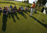 DM0222  Dustin Jensen, Director of Youth Programs for the Colorado Golf Association, teaches a...