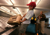 Cole Kennedy , 8 of Wisconsin and mom and dad Bill and Cyndi watch as he pulls a bag from the...