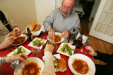 EJ373  Food Diary with artist Phil Bender, center.  He has dinner with friends at the home of...