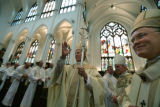Bishop James Conley blesses the crowd with Bishop Samuel Aquilo and Archbishop Charles Chaput at...