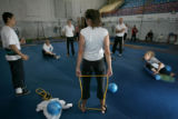 US Synchronized swimmer Janet Culp (back, center) and teammates do stretches at the Circus Center...