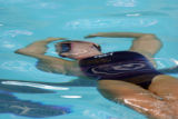 US Synchronized swimmer Janet Culp warms up before applying what she just learned on land in...