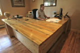 Mountain Valley Bank  President, Zack Jacobsen (cq), works at his new desk made out of beetle kill...