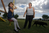 DM1080  Debbie Chisholm Kerr pushes her granddaughter Sierra Gifford, 6, on a swing behind her...