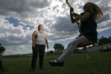 DM1098  Debbie Chisholm Kerr pushes her granddaughter Sierra Gifford, 6, on a swing behind her...