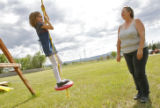 DM1131  Debbie Chisholm Kerr pushes her granddaughter Sierra Gifford, 6, on a swing behind her...