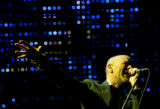 Michael Stipe, lead vocalist  of R.E.M., performs with the band at Red Rocks Amphitheatre in...