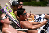 Brian Aragon (cq), center, hangs with friends at the pool at Lambertson Farms Apartmentrs, Tuesday...
