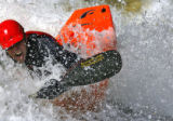 "DM0434  Joe Carberry, 31, plays in a rapid known as the ""C hole"" while kayaking on the..."