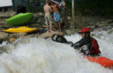 "DM0713  Joe Carberry, 31, plays in a rapid known as the ""C hole"" while kayaking on the..."
