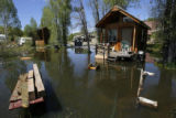 DM0830  Floodwaters from the Yampa River surround a cabin at the Steamboat Campground in Steamboat...