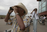 Owners Jane R Teutsch, right, and her husband Ray Teutsch (cq) watch their horses, Djet Set De...