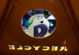 DM0070  A giant milk jug recycling mascot waves during the unveiling of the new 16th Street Mall...