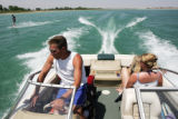 Don Meyer, front left, steers his boat around Boyd Lake near Loveland, Colo. on June 13, 2006,...