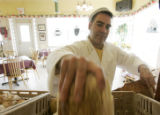 Greg Allan (cq) bags bread at his store, Vincenza's Italian Bakery & Deli, in Wheatridge,...