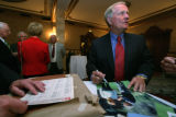 Famed Jack Nicklaus signs photographs and memoribilia at the Brown Palace Hotel, in Denver, Colo....