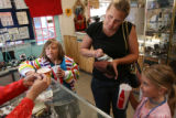 MJM033 Kayne Ames, 7, left to right, waits as mother, Ellie Ames (cq) pays for a necklace for...