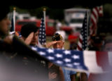 (PG8487) Military personnel salute as a flag is folded for the family of Sgt. Isaac Palomarez, 26,...