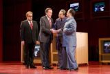On stage May 30, 2008 from left to right, Thomas Hammons plays Henry Kissinger, lead actor, Robert...
