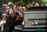 (PG8520) The family of Sgt. Isaac Palomarez, 26, of Loveland, grieves during his military burial...