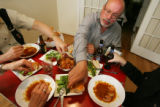 EJ371  Food Diary with artist Phil Bender, center.  He has dinner with friends at the home of...