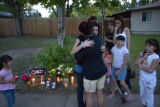 Carolina Valencia, 16 (cq) receives a hug in front of a memorial set up for her father, Odiceo...