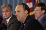 (Background to Foreground) Denver District Attorney Mitch Morrissey, Denver Mayor John...