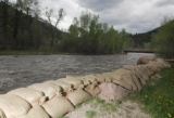 Sandbags line the bank of the Crystal River as a precaution against rising water levels outside of...