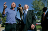 BG0235 Denver Broncos owner Pat Bowlen, left, and primary donor for the statue Doug Morton stand...