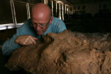 Kent Hups science teacher at Manuel HS examines part of his fossil in Denver, Colo. on Wednesday...