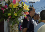 Denver Police Chief Gerry Whitman, Luis Romero, and Denver D.A. Mitch Morrisey, left to right,...