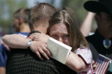 Cousin Tiffany Davies (cq), 29, gives a hug to family friend Brandon Lane (cq), 25, at the funeral...