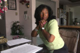 Michele Wheeler (cq)  in her Aurora home Thursday May 22,2008. Wheeler blames Rev. Acen Phillips...