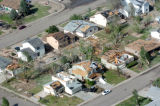 Houses in the southeast part of the town of Windsor show the massive damage a tornado caused...