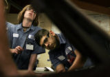 (069) Pickens Technical College Auto Mechanics students Travis Cooper, left, and Victor Hernandez,...