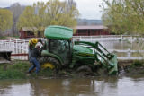 Workers from the Saddleback Mountain Ranch, WOULD NOT GIVE NAMES, work on getting a tractor...
