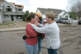 BG0052 BG0062 April Heims,(((606 Canosha C.{sp} )))) left is comforted by a neighbor as she...