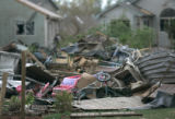 BG0532 Debris and parts of homes fill a back yard in a neighborhood near 257 and Eastman Kodak...