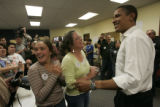 Barack Obama makes voter contact phone calls from the Obama for President in Brighton, CO, October...