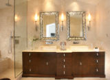 The master bath, with a custom vanity made of burled walnut veneer, and white onyx counters and...
