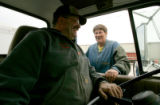 BG0502 Tony Bremenkamp, left and Toni Ackerman, right, have a laugh while waiting to unload...